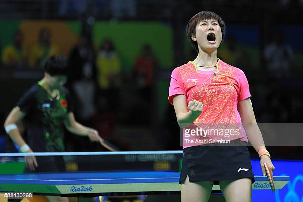 Ding Ning of China celebrates winning the gold medal after the Women's Table Tennis Gold Medal match against Li Xiaoxia of China at Rio Centro on...