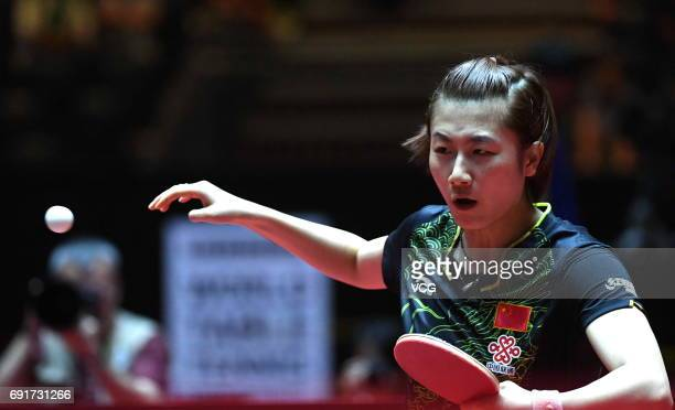 Ding Ning of China competes during Women's Singles quarterfinals against Japan's Kasumi Ishikawa on day 5 of World Table Tennis Championships at...