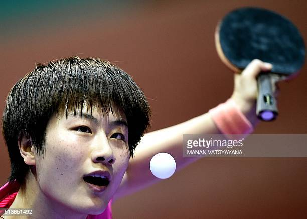Ding Ning of China hits a return against Chen Szuyu of Taiwan during their women's singles semifinal match of the 2016 World Team Table Tennis...