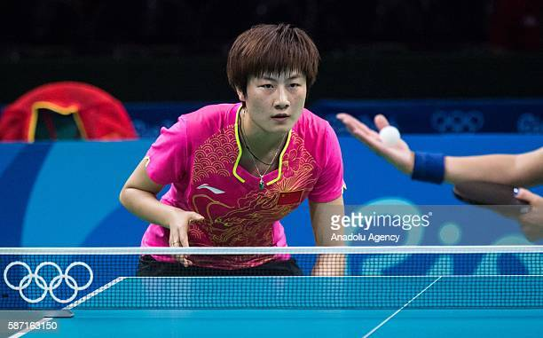 Ding Ning of China in action against Samara Elizabeta of Romania during women's singles third round match on second day of the Rio 2016 Olympic Games...