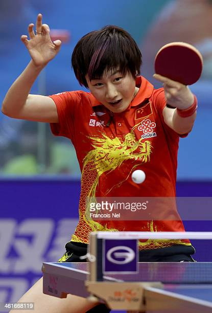 Ding Ning of China plays a shot in the quaterfinals of the Women's singles during the GAC Group 2013 ITTF World Tour Grand Finals at the Al Nasr...