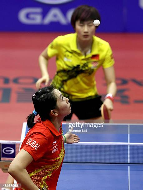 Ding Ning of China plays against Li Xiaoxia of China in the semi finals of the Women's singles during the GAC Group 2013 ITTF World Tour Grand Finals...