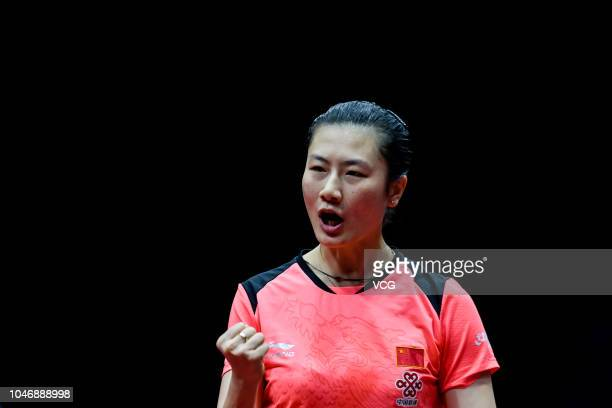 Ding Ning of China reacts in the Women's Singles semifinal match against Kasumi Ishikawa of Japan on day three of 2018 ITTF Women's World Cup at...