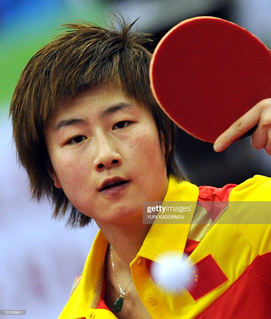 Ding Ning of China returns a servE to Ai Fukuhara of Japan during the women's semi final at the 2010 World Team Table Tennis Championships in Moscow on May 29, 2010.