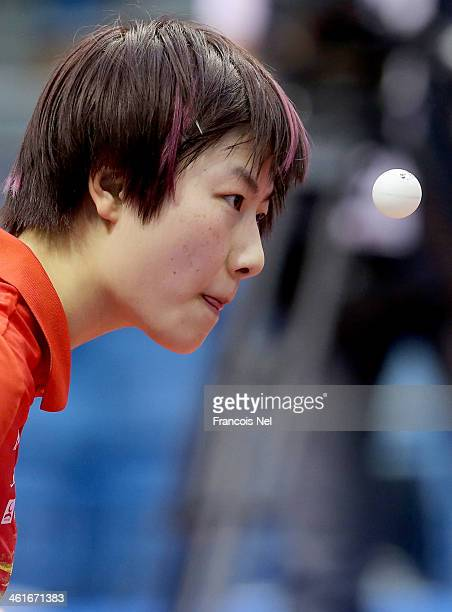 Ding Ning of China serve to Feng Tianwei of Singapore in the quarterfinals of the Women's singles during the GAC Group 2013 ITTF World Tour Grand...