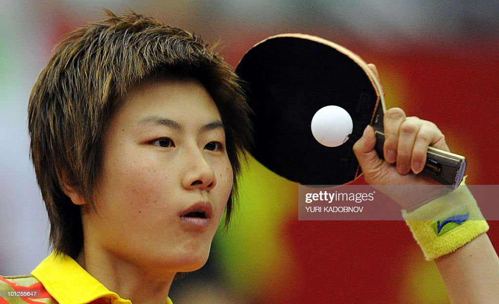 Ding Ning of China serves to Ai Fukuhara of Japan during the women's semi final at the 2010 World Team Table Tennis Championships in Moscow on May 29, 2010.