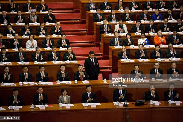Ding Xuexiang member of Political Bureau of Communist Party of China's Central Committee second row from left to right Han Zheng China's executive...