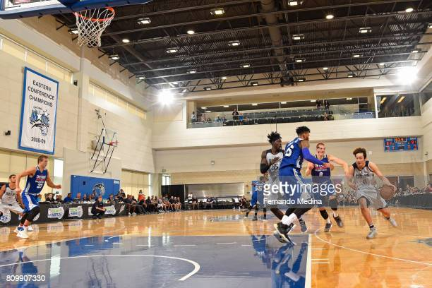 Ding Yanyuhang drives to the basket and passes the ball to Johnathan Motley of the Dallas Mavericks for the game wining shot during the Mountain Dew...