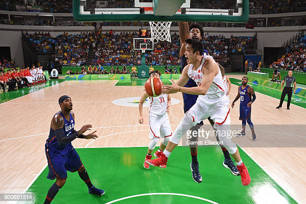 Ding Yanyuhang of China goes to the basket against the USA Basketball Men's National Team on Day 1 of the Rio 2016 Olympic Games at Carioca Arena 1...