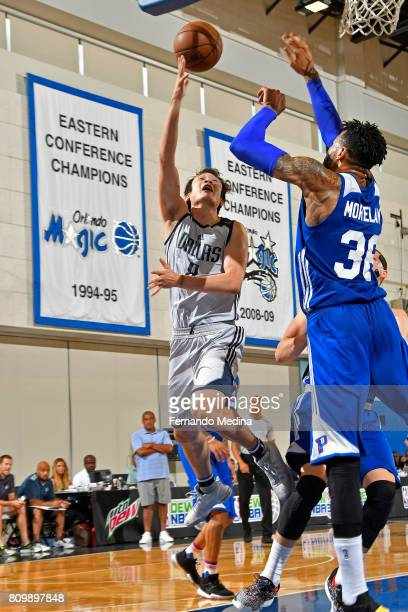 Ding Yanyuhang of the Dallas Mavericks drives to the basket against the Detroit Pistons during the Mountain Dew Orlando Pro Summer League...