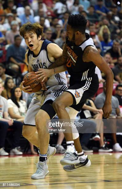 Ding Yanyuhang of the Dallas Mavericks is fouled by Derrick Jones Jr #10 of the Phoenix Suns during the 2017 Summer League at the Thomas Mack Center...