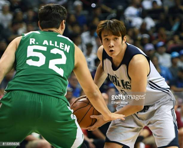 Ding Yanyuhang of the Dallas Mavericks is guarded by Rosco Allen of the Boston Celtics during the 2017 Summer League at the Thomas Mack Center on...