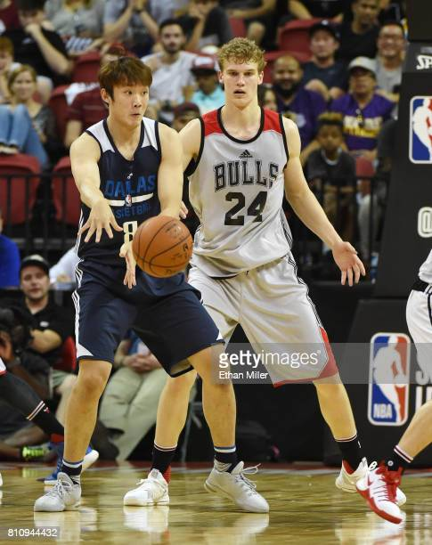 Ding Yanyuhang of the Dallas Mavericks passes against Lauri Markkanen of the Chicago Bulls during the 2017 Summer League at the Thomas Mack Center on...