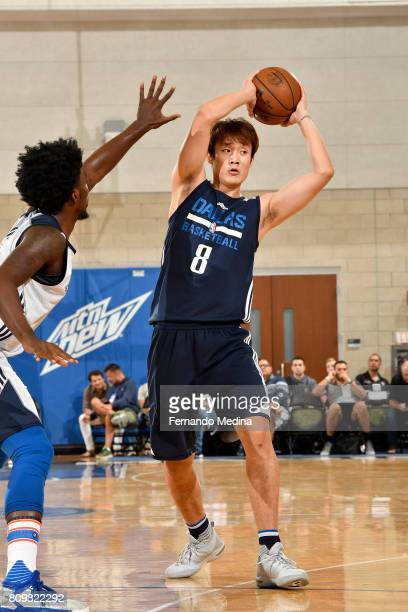 Ding Yanyuhang of the Dallas Mavericks passes the ball against the Oklahoma City Thunder during the Mountain Dew Orlando Pro Summer League on July 5...