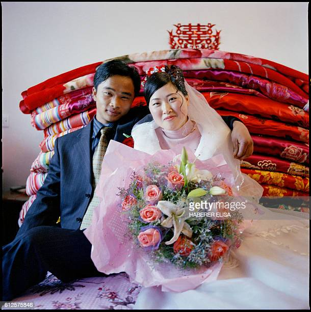Ding Zhifa and Cai Xingju wed in Wei Ding, a village of 400 inhabitants located 150 kilometers from Hefei, capital of the Anhui province. The couple...