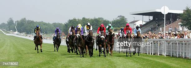 Dingaan ridden by Williams Buick wearing purple and yellow silks crosses the line to win The Empire Property Group Handicap Stakes at the Goodwood...