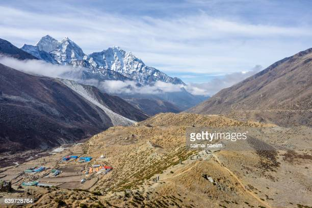 Dingboche village in the morning with Kangtega and Thamserku mountain peak in the background