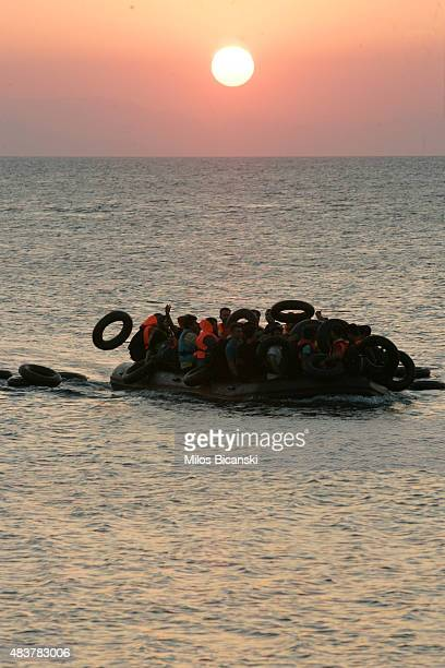 A dinghy overcrowded with Syrian migrants approaches a beach on the Greek island of Kos after crossing a part of the Aegean sea from Turkey to Greece...