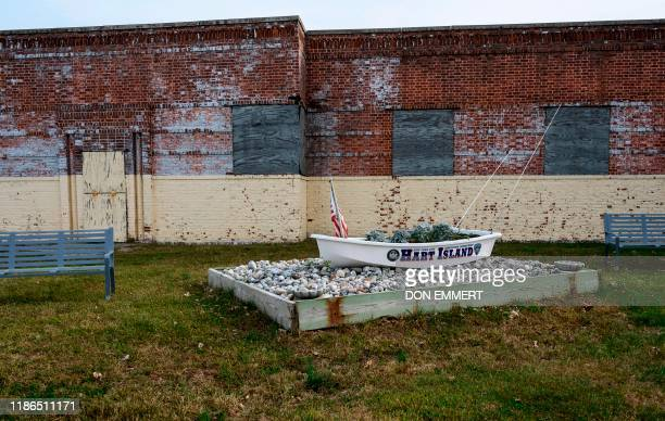 A dinghy sits near the ferry dock and greets visitors to the Potter's field at Hart Island October 25 2019 in New York Elaine Joseph's baby daughter...
