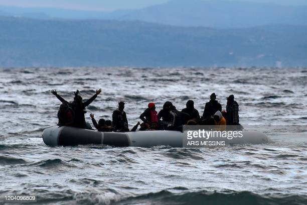 Dinghy transporting 27 refugees and migrants originating from Gambia and the Republic of Congo is pulled towards Lesbos island after being rescued by...
