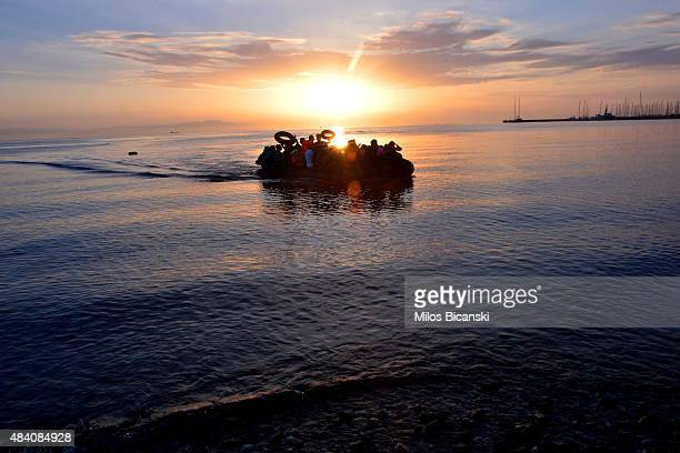 A dinghy with Syrian refugees arrives at a beach on the Greek island of Kos after crossing a part of the Aegean sea from Turkey to Greece on August...