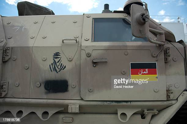 Dingo armoured vehicle returning from Afghanistan is unloaded from a ship on August 10 2013 in Emden Germany Germany which participated in the...
