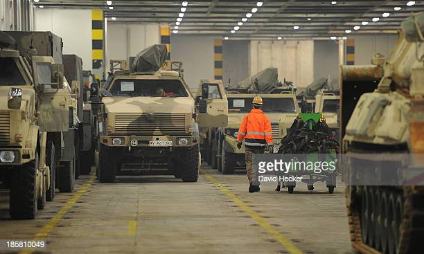 Dingo armoured vehicles returning from Afghanistan and being unloaded from a ship on October 25 2013 in Emden Germany Germany participated in the...