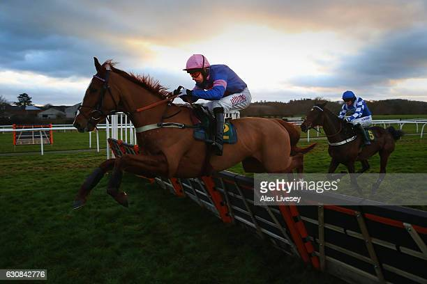 Dingo Dollar ridden by Wayne Hutchinson clear the last fence on their way to victory in the Le Chalice Maiden Hurdle Race at BangorOnDee Racecourse...