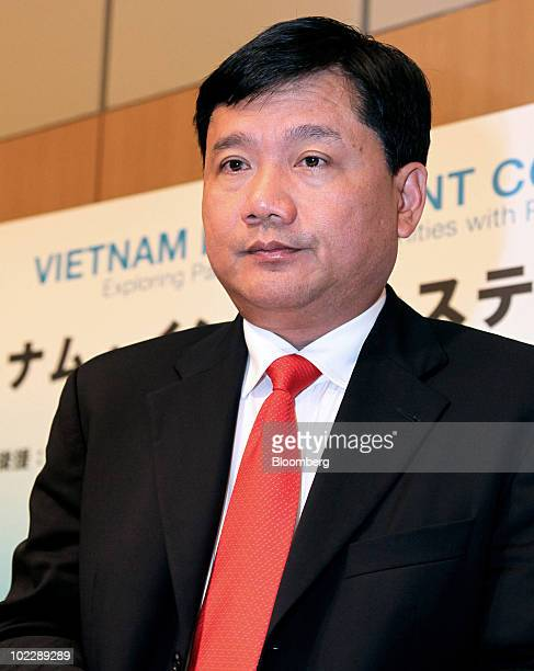 Dinh La Thang chairman of Vietnam Oil Gas Group also known as PetroVietnam leaves a news conference following a Vietnam investment seminar in Tokyo...