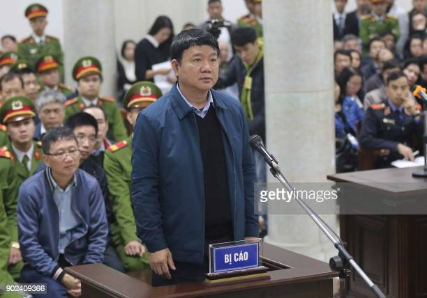 Dinh La Thang former politburo member and former Chairman of Vietnam's National Oil Company PVN stands trial next to Trinh Xuan Thanh a former oil...