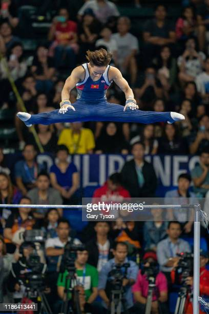 Dinh Phuong Thanh from Vietnam takes the Gold Medal in the Mens Horizontal Bars Final of the Southeast Asian Games on December 04 2019 in Manila...