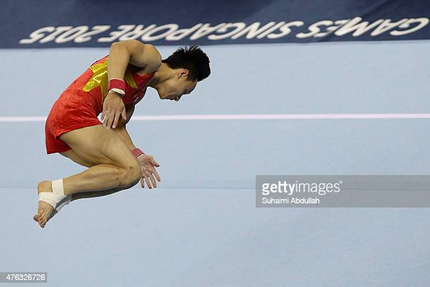Dinh Phuong Thanh of Vietnam in action during the floor event in the men's gymnastic individual allaround final at the Bishan Sports Hall during the...