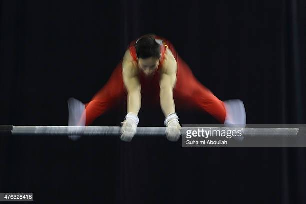 Dinh Phuong Thanh of Vietnam in action during the horizontal bar event in the men's gymnastic individual allaround final at the Bishan Sports Hall...
