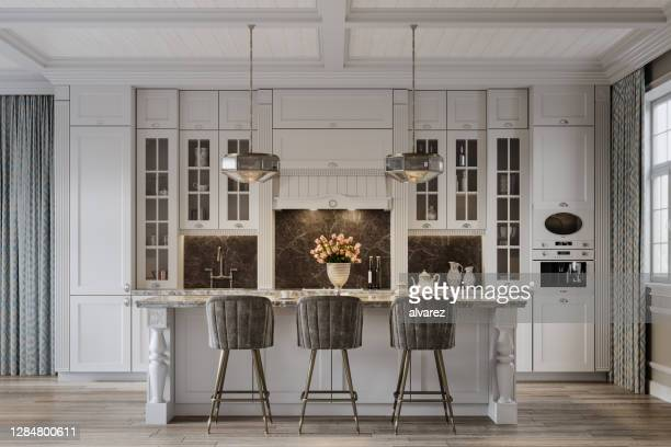 dining area in a beautiful modern kitchen from a large house - tradition stock pictures, royalty-free photos & images