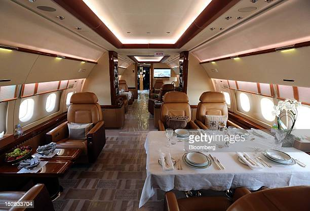 A dining area is seen ready for service onboard an Airbus A319 aircraft produced by Airbus SAS at the Jet Expo 2012 exhibition at Vnukovo airport in...