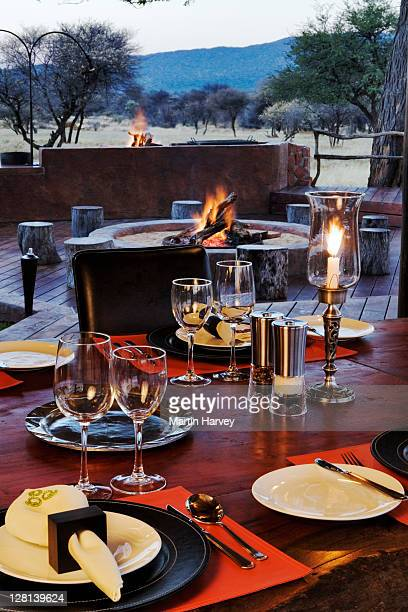 Dining area of the Villa in Okonjima Private Game Reserve, Namibia. Africa. Here guests gather in the evenings for a taste of heartfelt hospitality, with open-fires blazing outside to enhance the feeling of safari living. (PR: Property Released)