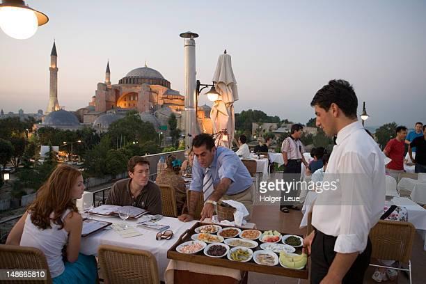 Dining at Seven Hills Roof Cafe & Restaurant in Sultanhamet, with Aya Sofya in background.