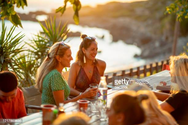 dining at the beach taverna - greece stock pictures, royalty-free photos & images