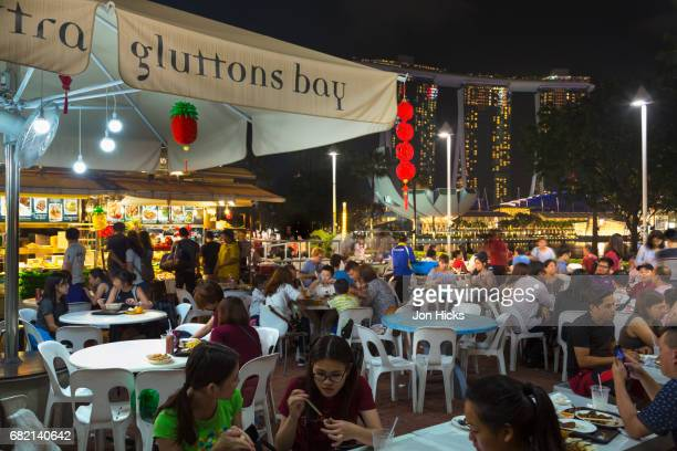 Dining at the Makansutra Gluttons Bay food center in Singapore.