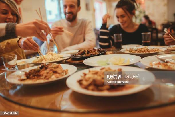 dining in a chinese restaurant - chinese food stock pictures, royalty-free photos & images
