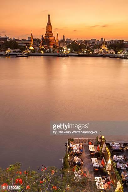 Dining on Chao Phraya Riverbank at Sunset