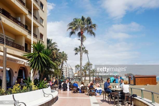 Dining on the paseo maritimo, the seaside promenade, Estepona, Costa del Sol, Malaga Province, Andalusia, southern Spain.
