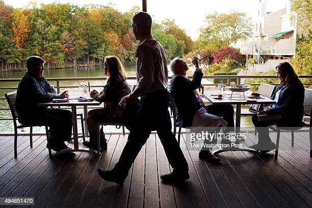 RESTON VA Dining on the patio overlooking Lake Thoreau at Red's Table restaurant photographed in Reston VA