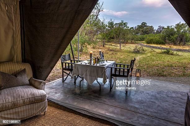 Dining outside of luxury tent, Machaba Camp, Okavango Delta, Botswana
