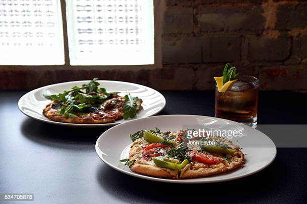 Dining review of Chow Urban Grill May 26 2016 including the flatbread pizzas with a Murphy's Hellcat drink Also in the review a tomato burrata and...