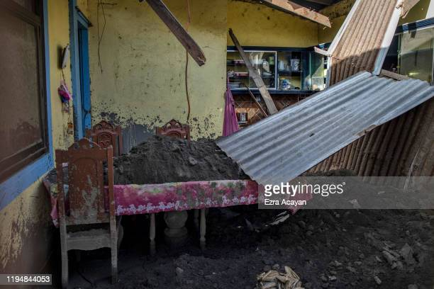 A dining room of a house whose roof has collapsed due to heavy volcanic ash from Taal Volcano's eruption is seen on January 20 2020 in the village of...