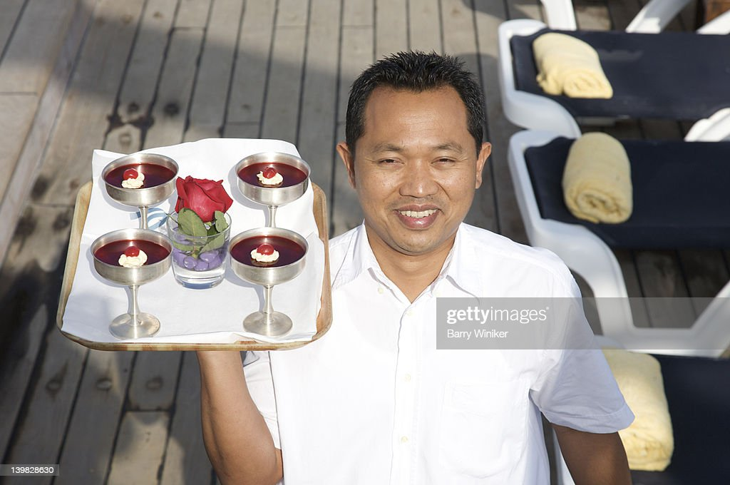 Dining Room Steward On Deck With Dessert Cups Aboard Cruise Ship - Steward cruise ship