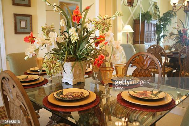 Dining Room Table and Chairs with Floral Arrangement