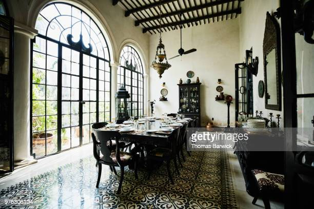 dining room table set for celebration dinner in home - arch stock pictures, royalty-free photos & images