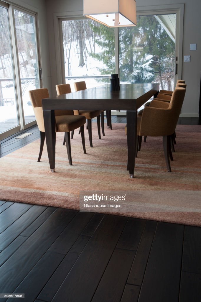 Enjoyable Dining Room Table With Upholstered Orange Chairs On Area Rug Interior Design Ideas Philsoteloinfo